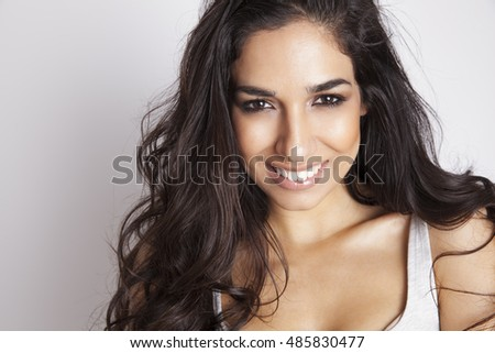Portrait of beautiful smiling woman with elegant hairstyle and perfect soft makeup. Brunette girl. Pure beauty. Long hair. Wellness.Fashion photo.