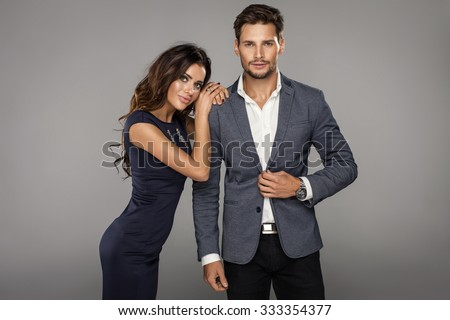 Portrait of beautiful smiling woman with handsome man