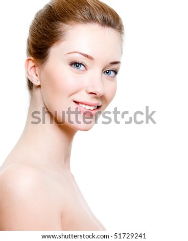 Portrait of beautiful smiling woman with healthy skin
