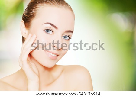 portrait of beautiful smiling woman with perfect skin