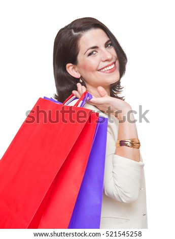 Portrait of beautiful smiling woman with shopping bags.