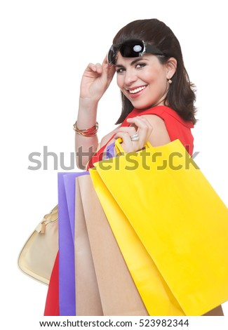 Portrait of beautiful smiling woman with shopping bags and glasses.