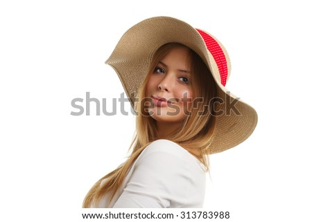 Portrait of beautiful smiling woman with straw hat. Isolated on white.
