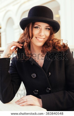 Portrait of beautiful smiling young girl in a hat - stock photo
