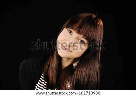 Portrait of beautiful smiling young girl. Other black background - stock photo