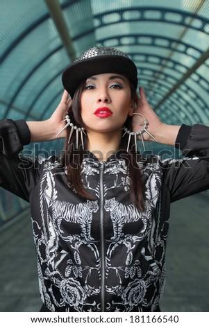 portrait of beautiful stylish asian girl in tunnel - stock photo