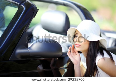 portrait of beautiful summer woman in the cabrio car - stock photo
