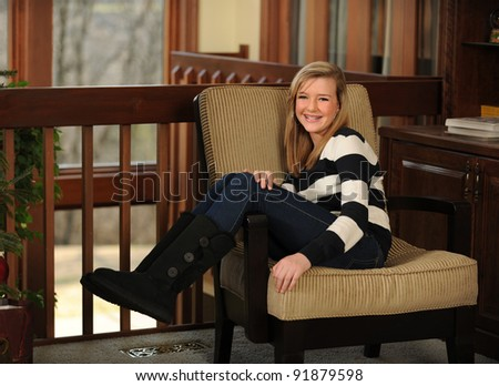 Portrait of beautiful teen girl smiling seated - stock photo