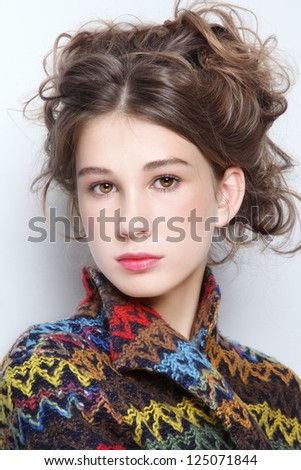 Portrait of beautiful teen girl with curly hair - stock photo