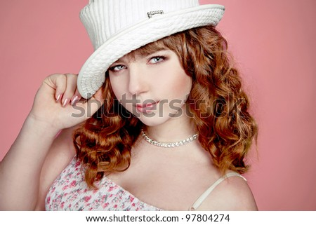 Portrait of beautiful teenager girl with red curly hairs and hat - stock photo