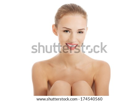 Portrait of beautiful topless caucasian woman. Spa concept. Isolated on white.