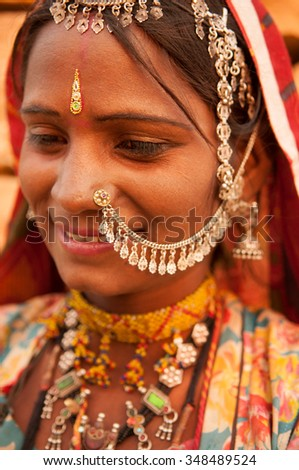 Portrait of beautiful traditional Indian woman in sari costume covered her head with veil, India people