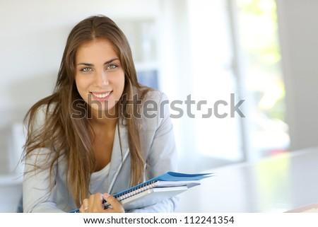 Portrait of beautiful university girl - stock photo