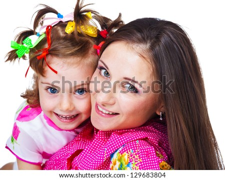 Portrait of beautiful woman and her daughter - stock photo