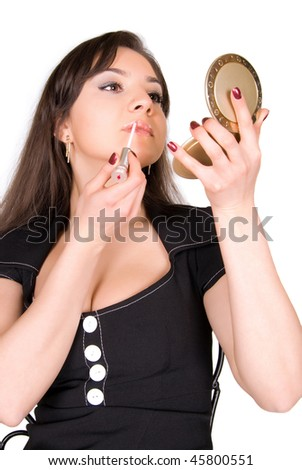Portrait of beautiful woman applying lipstick over white background