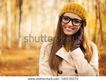 Portrait of beautiful woman at autumn - stock photo