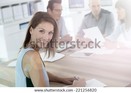 Portrait of beautiful woman attending business meeting - stock photo