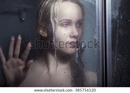 Portrait of beautiful woman bathing in darkness