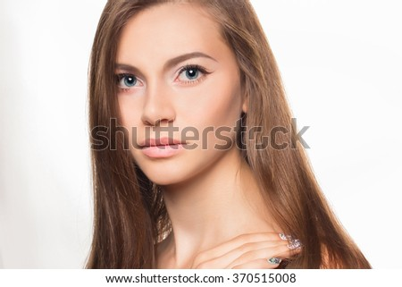 Portrait of beautiful woman. Beautiful woman with evening make-up. Beauty Fashion Model Woman touching her Long and Healthy Brown Hair. Fashion photo - stock photo
