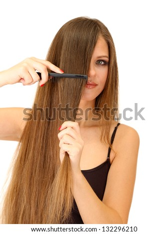 Portrait of beautiful woman brushing her hair, isolated on white