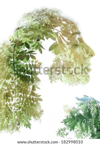 Portrait of beautiful woman combined with photograph of nature in trendy double exposure technique.  - stock photo