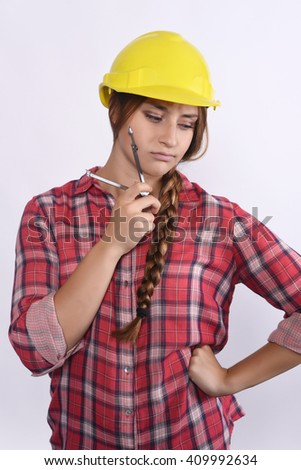 Portrait of beautiful woman construction worker thinking and seriously. Isolated white background.