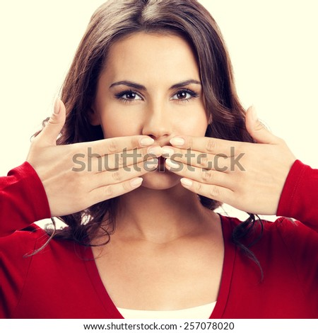 Portrait of beautiful woman covering with hands her mouth - stock photo