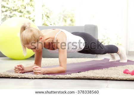 Portrait of beautiful woman doing yoga at home.