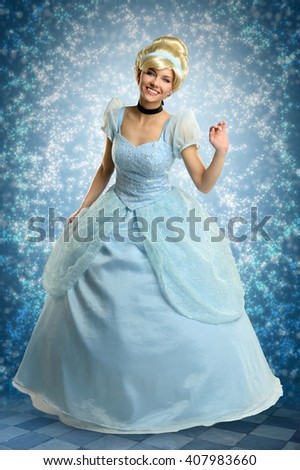 Portrait of beautiful woman dressed in princess costume over magical background - stock photo