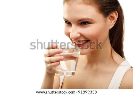 Portrait of beautiful  woman drinking water isolated on white - stock photo