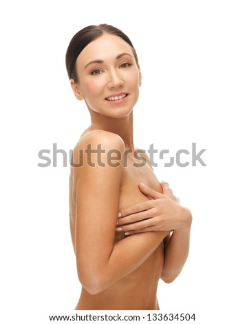 portrait of beautiful woman holding her breast - stock photo