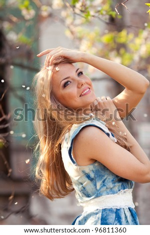 portrait of beautiful woman in blooming in spring - stock photo