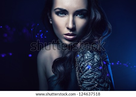 portrait of beautiful woman in blue light - stock photo