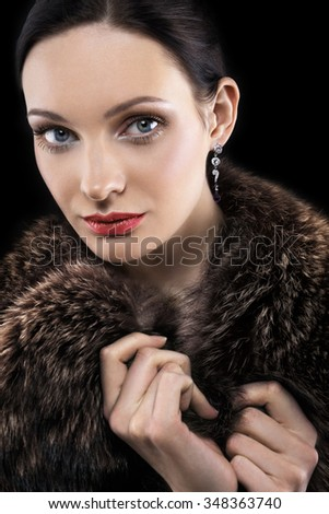 Portrait of beautiful woman in fur coat - stock photo