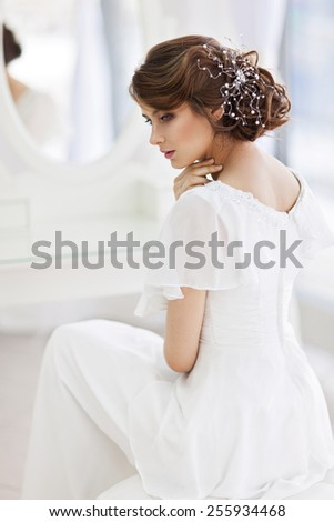 Portrait of beautiful woman in girlish bedroom - stock photo