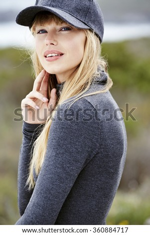 Portrait of beautiful woman in gray clothing