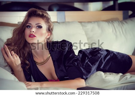 Portrait of beautiful woman in home interior - stock photo