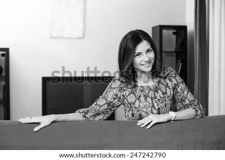 Portrait of beautiful woman in living room