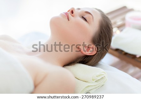 Portrait of beautiful woman in massaging room