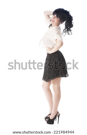 Portrait Of Beautiful Woman In Skirt And Blouse Standing Over White Background - stock photo