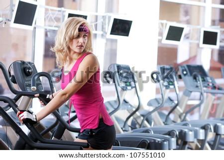 Portrait of beautiful woman in sport gym - stock photo