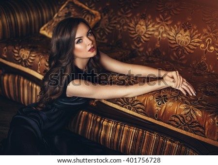 Portrait of beautiful woman in the black dress - stock photo