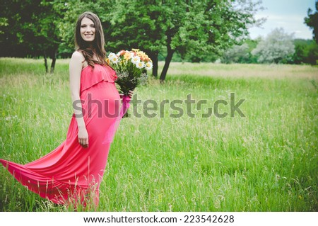 Portrait of beautiful woman in the  park - stock photo