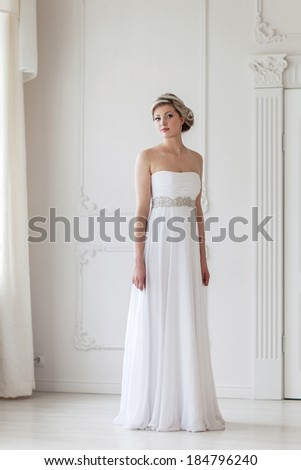 Portrait of beautiful woman in white dress - stock photo