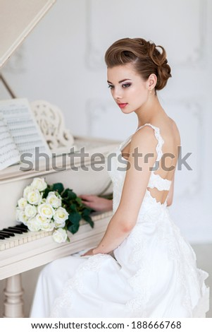 Portrait of beautiful woman in white dress - stock photo
