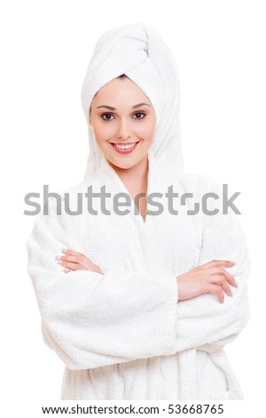 portrait of beautiful woman in white towel and bathrobe - stock photo