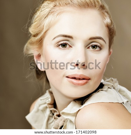 Portrait of beautiful woman isolated on beige