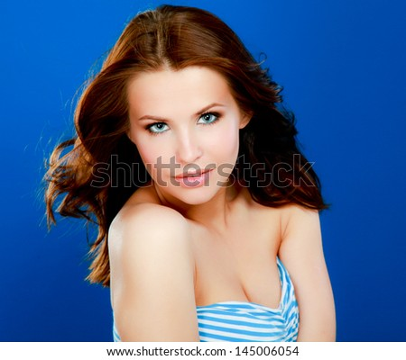Portrait of beautiful woman , isolated on blue background - stock photo