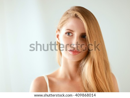 Portrait of beautiful woman isolated on gray background