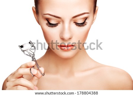 Portrait of beautiful woman making curl eyelashes. Beautiful woman face. Perfect make-up - stock photo